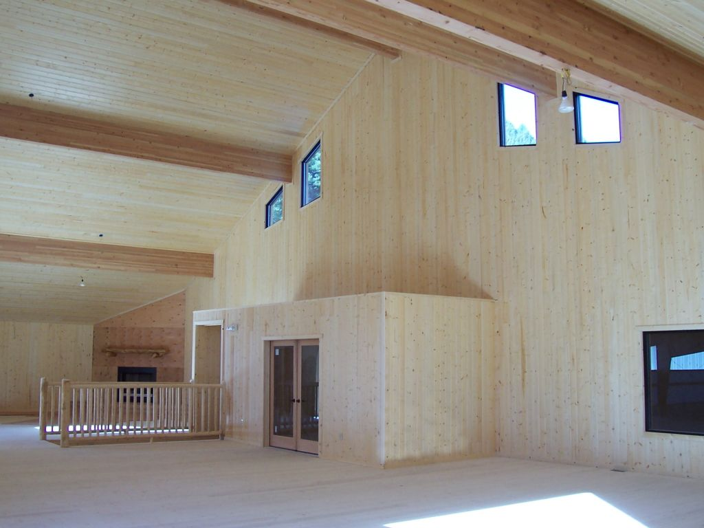 Interior of riding arena observation room that is paneled in tongue and groove wood.