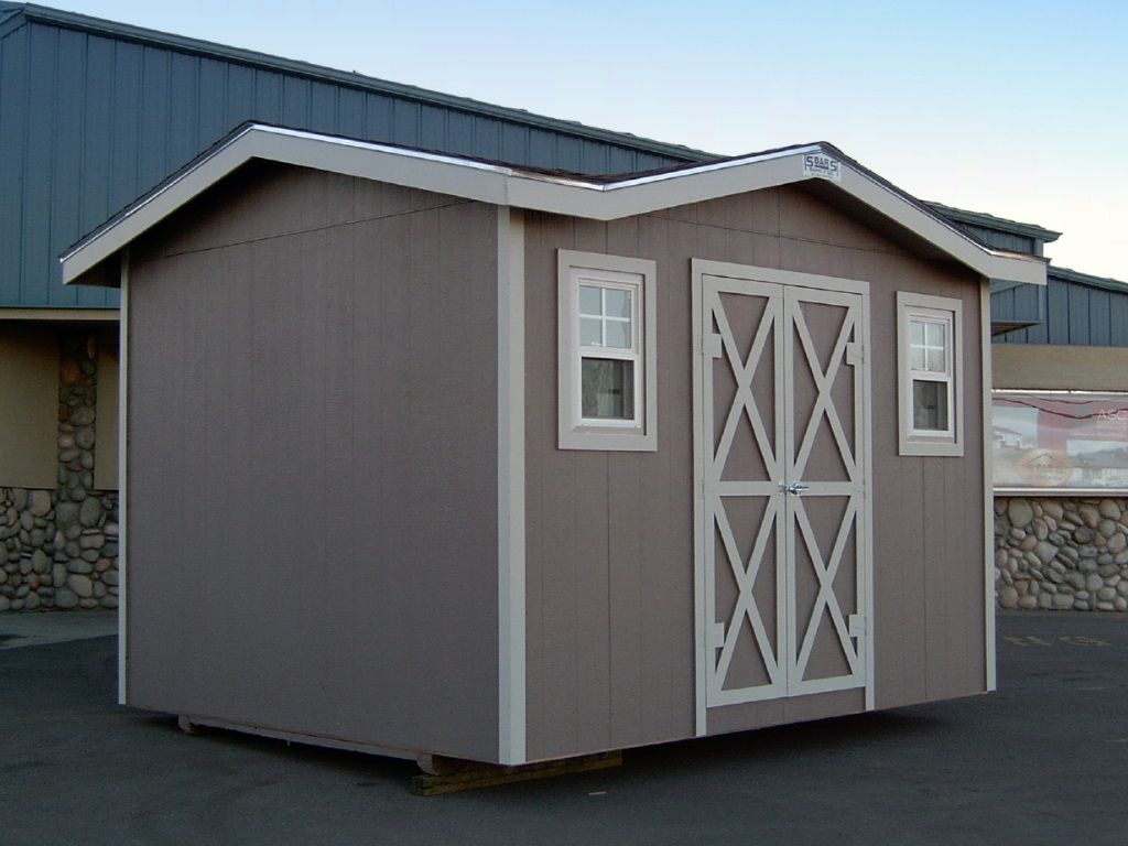 Shed with customized multi-angled roof and windows on each side of the shed door.