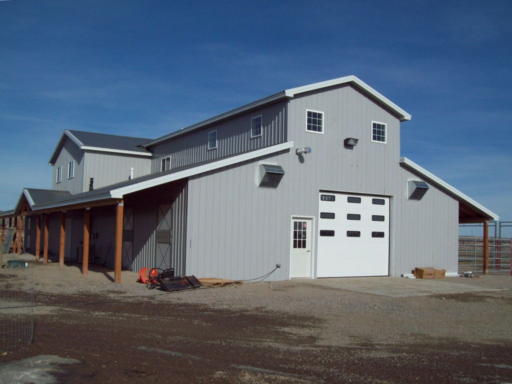 End of barn with monitor style roof and extended lean-tos on each side.