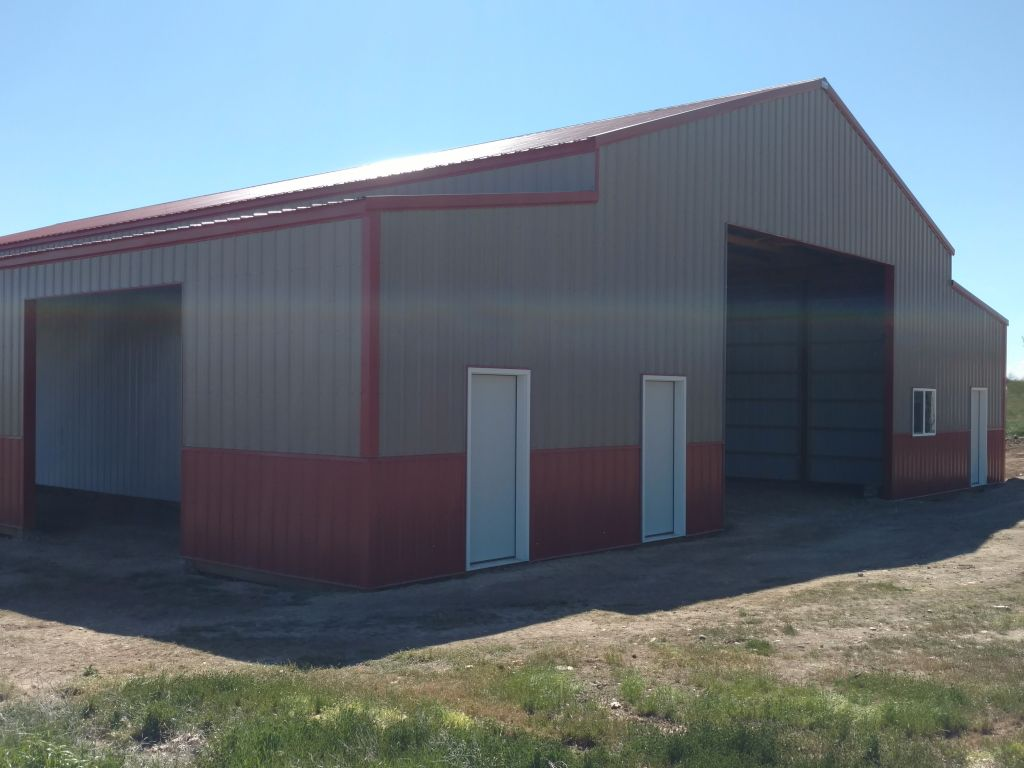 Pole barn with enclosed lean-to's on each side. Barn red trim and wainscot and details.