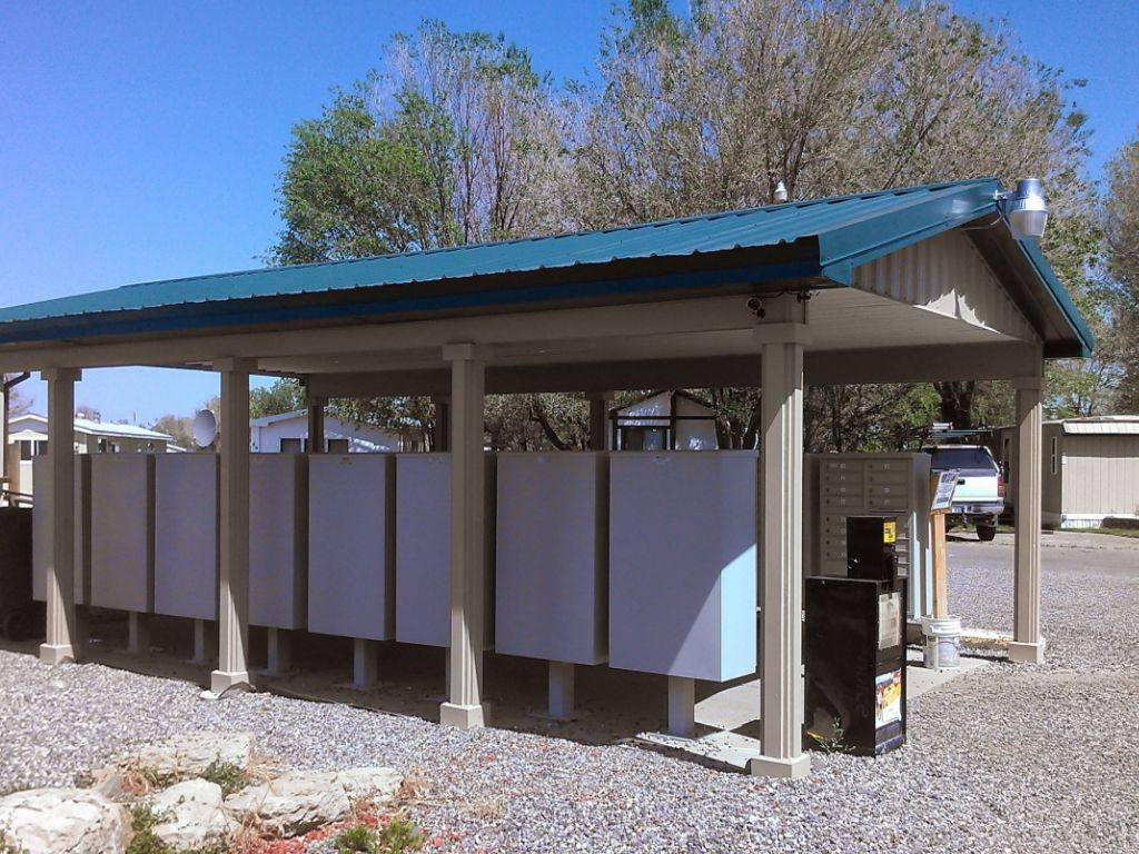 Open-sided post-frame construction project that covers multiple mail boxes.