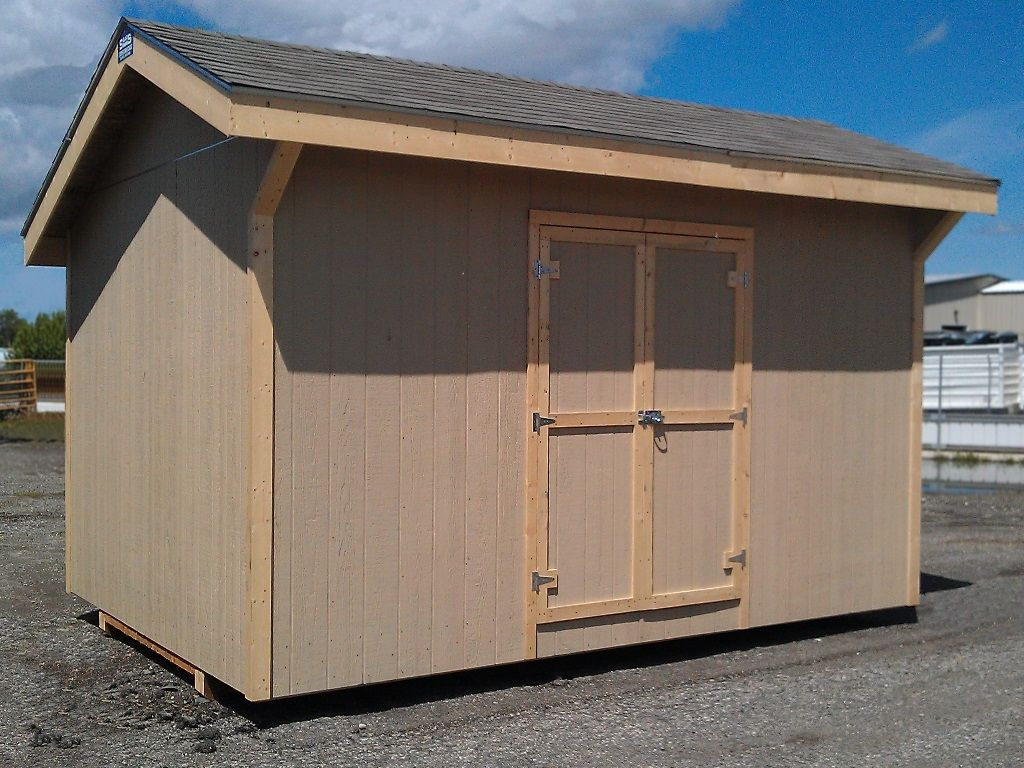 Shed with off center roof peak and overhanging eaves.