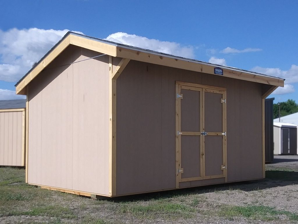 Side view of a Pioneer style shed with it's off center roof peak and eaved roof.