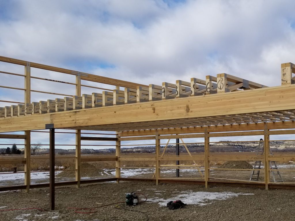 Construction detail that shows the floor trusses used between stories in a pole barn.