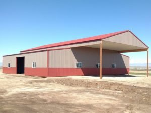 Side view of a pole barn with an extended roof.