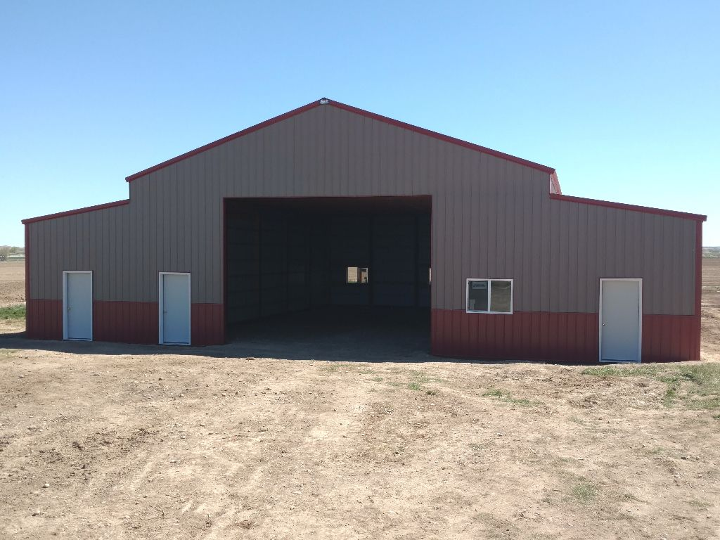 Large overhead door lets you see into the interior a pole barn.