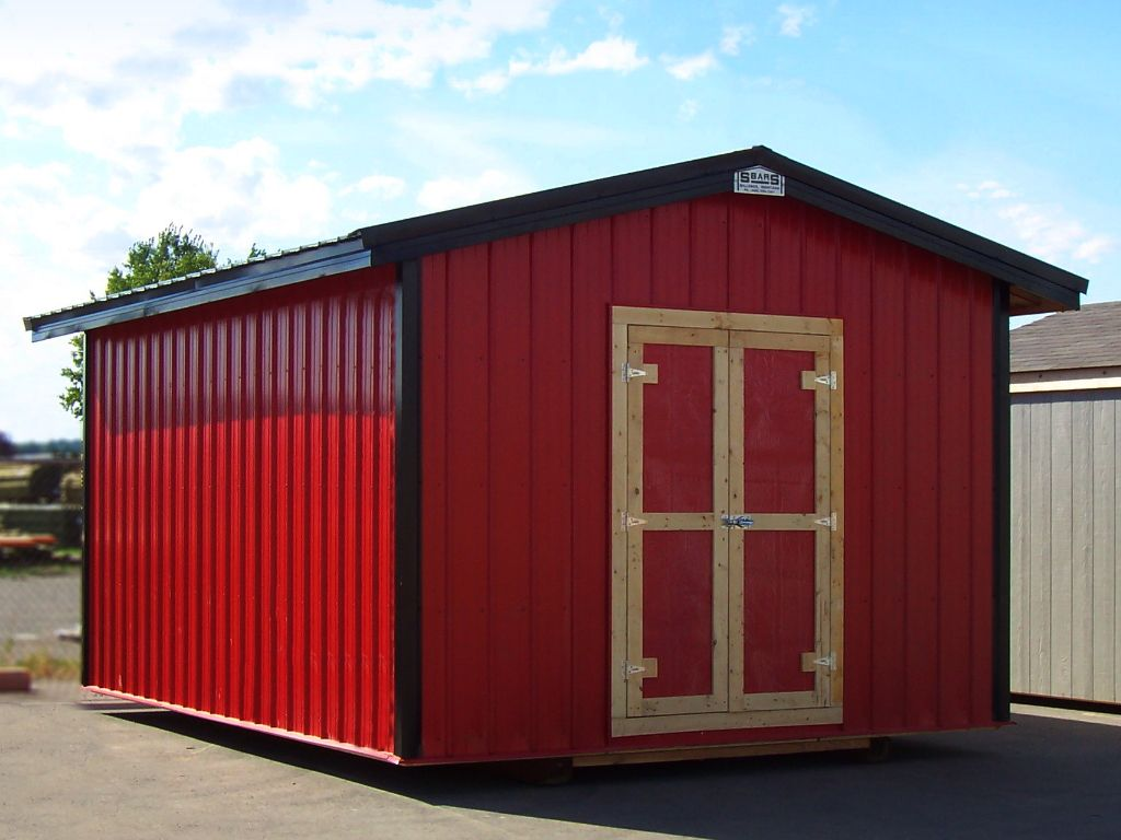 Red steel shed with black trim and roof. Shed has a gable roof with overhanging eaves.