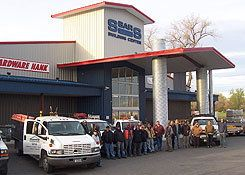 Front of the S-Bar-S retail building with crew truck and employee team gathered around.