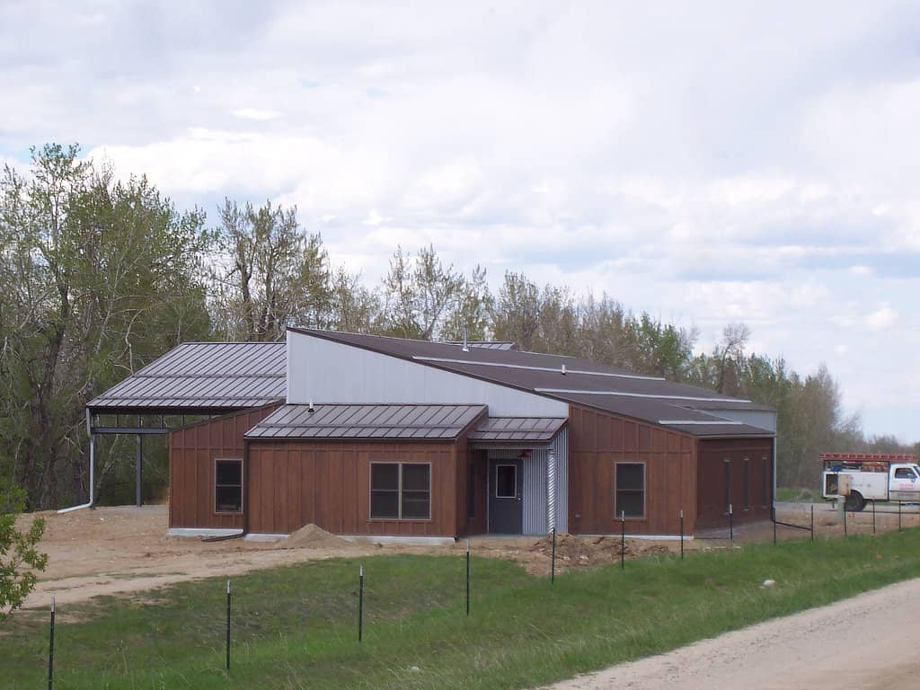 Commercial building with steel roof and custom wood siding.