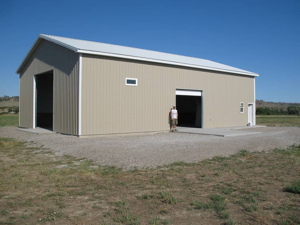 Finished pole barn with two overhead doors.