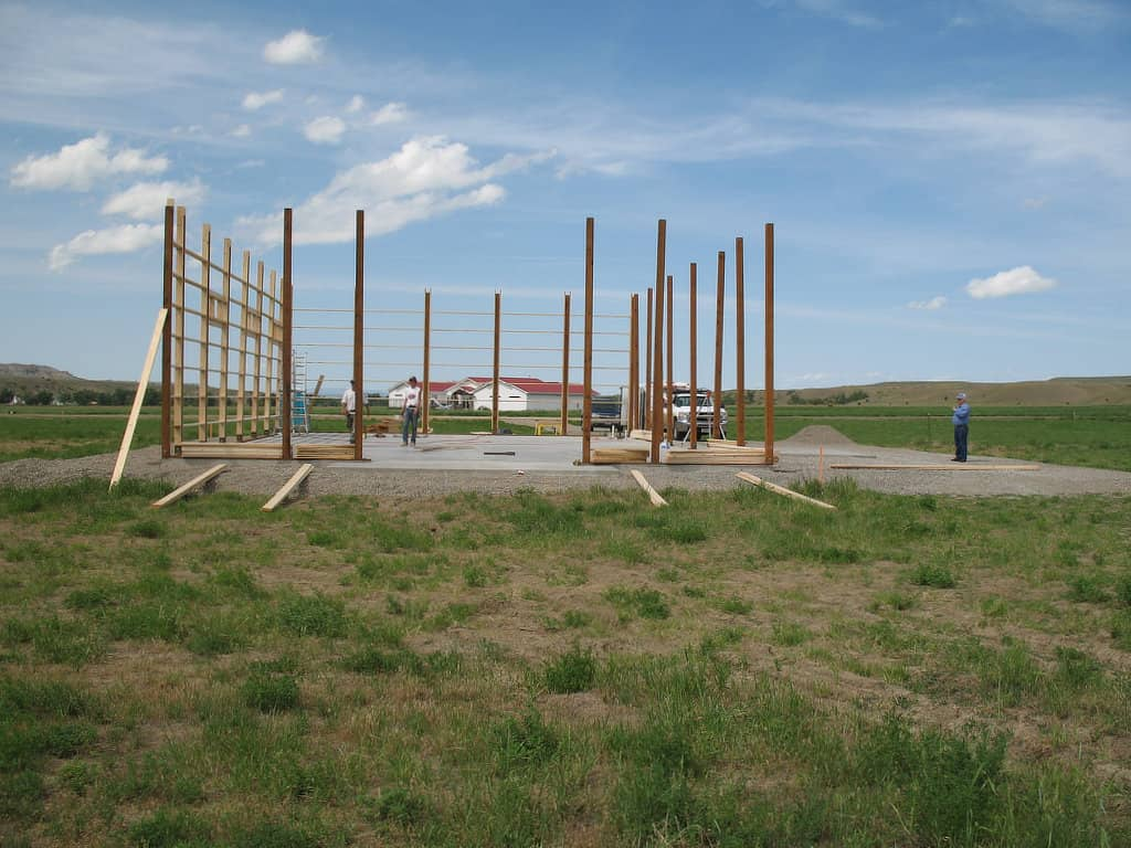 Putting up turned girt framing between the posts of a pole barn.
