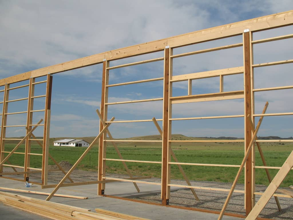 Top plate awaiting trusses on a pole barn frame.