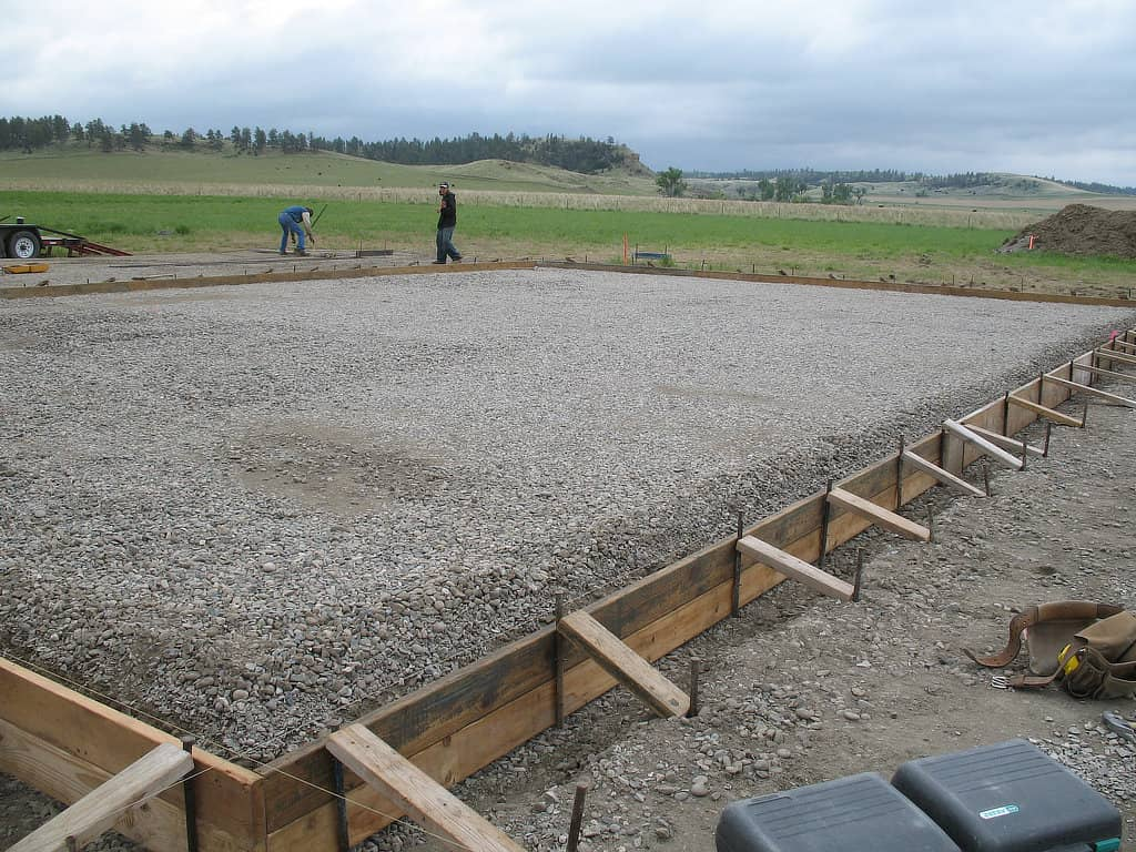 Concrete form with prepped base that will become a floor for a pole barn.