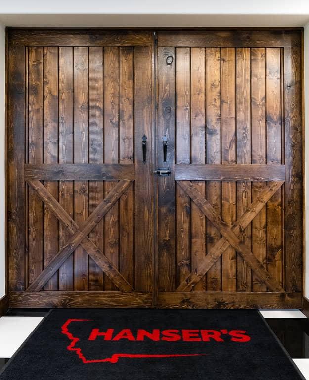 Custom wooden sliding barn doors built by S-Bar-S for the Rusty Roost at Hanser's.