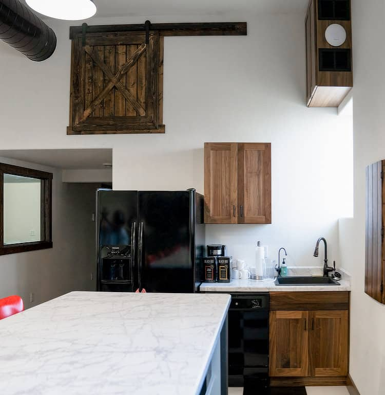 Kitchen area with custom wood sliding door at the Rusty Roost.