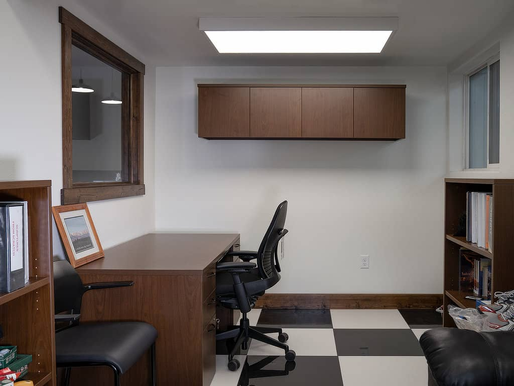 Office area with desk and windows at the Rusty Roost.