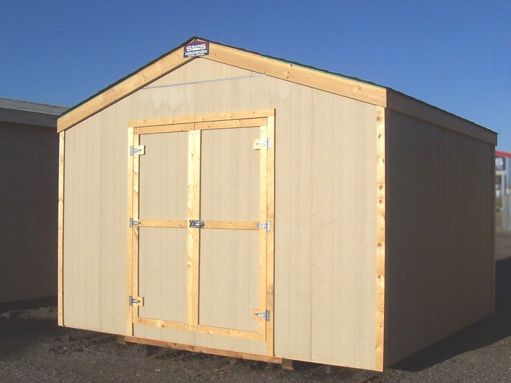 Gable-roofed shed with no overhang and shed style doors on the end. Hardboard siding and wood trim.
