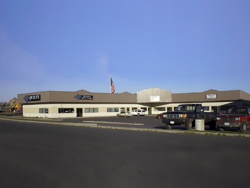 Commercial complex with three retail establishments.