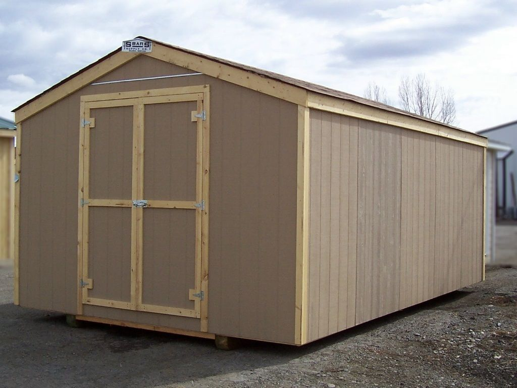 Gable-roofed shed with no overhang and shed style doors on the end. Brown shingles and wood trim.
