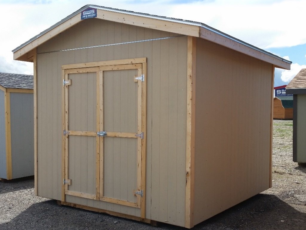 Shed with eaved, gable roof covered in shingles and hardboard siding.