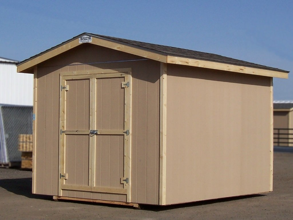 Side view of a gable-roofed shed with an overhang. It has hardboard siding and wood trim.