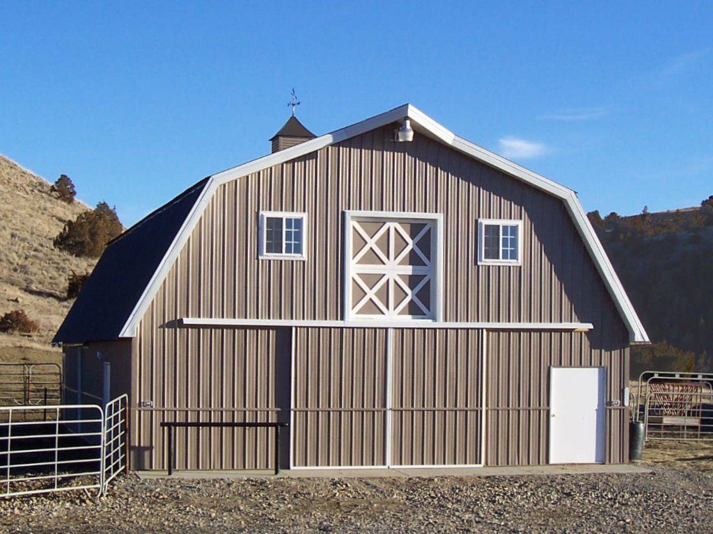 Steel gambrel pole barn with a sliding barn door as built by S-Bar-S