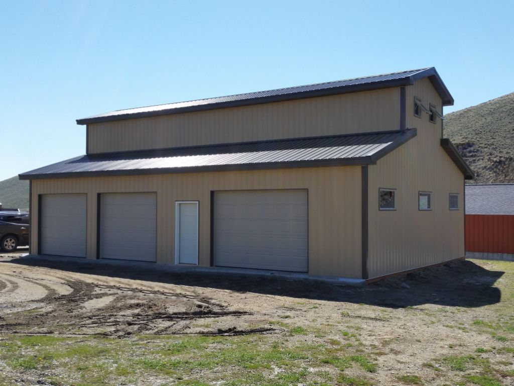 Three bay post-frame garage built with a monitor style roof.
