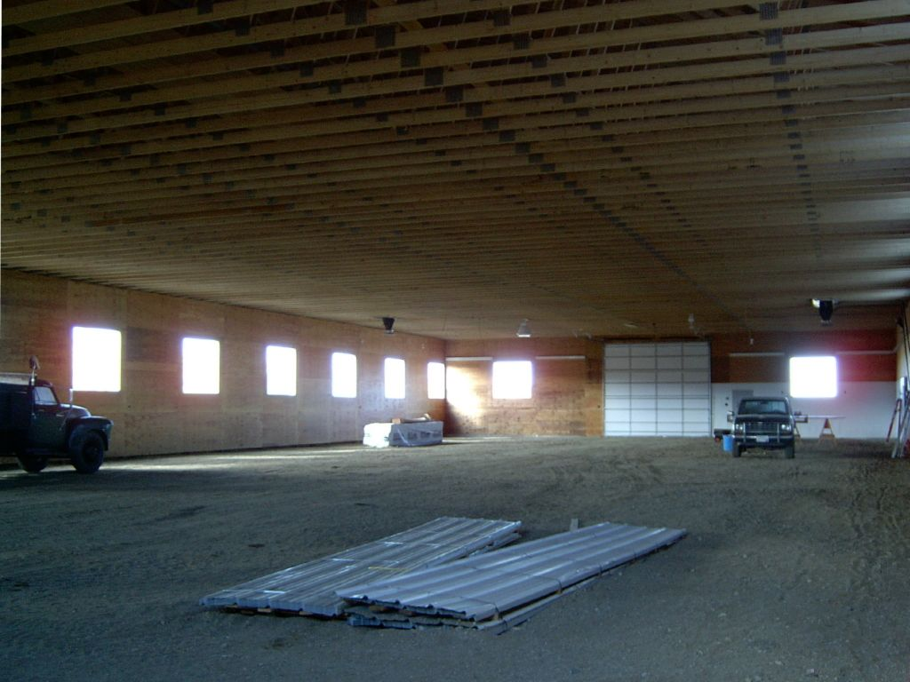 Interior of a riding arena that is still under construction.