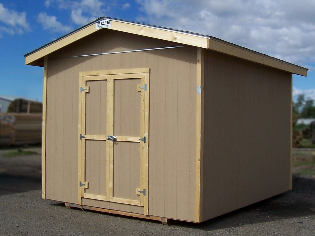 A shed with an eaved, gable roof, hardboard siding and wood trim.