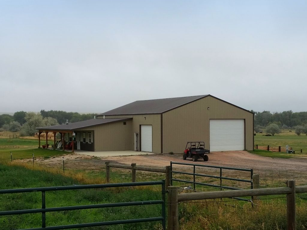 A home and shop combination built by S-Bar-S. A covered porch lines one side.