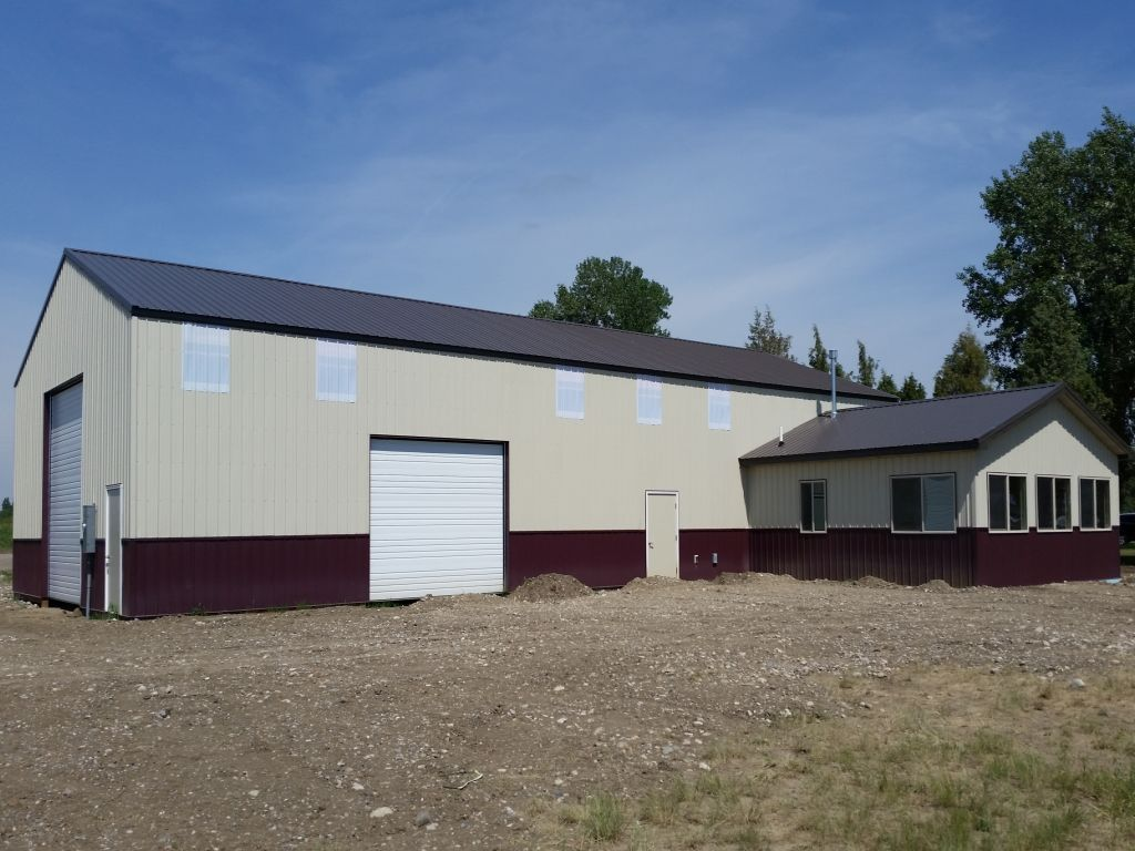 A pole barn shop with an attached office all have burgandy steel wainscot.