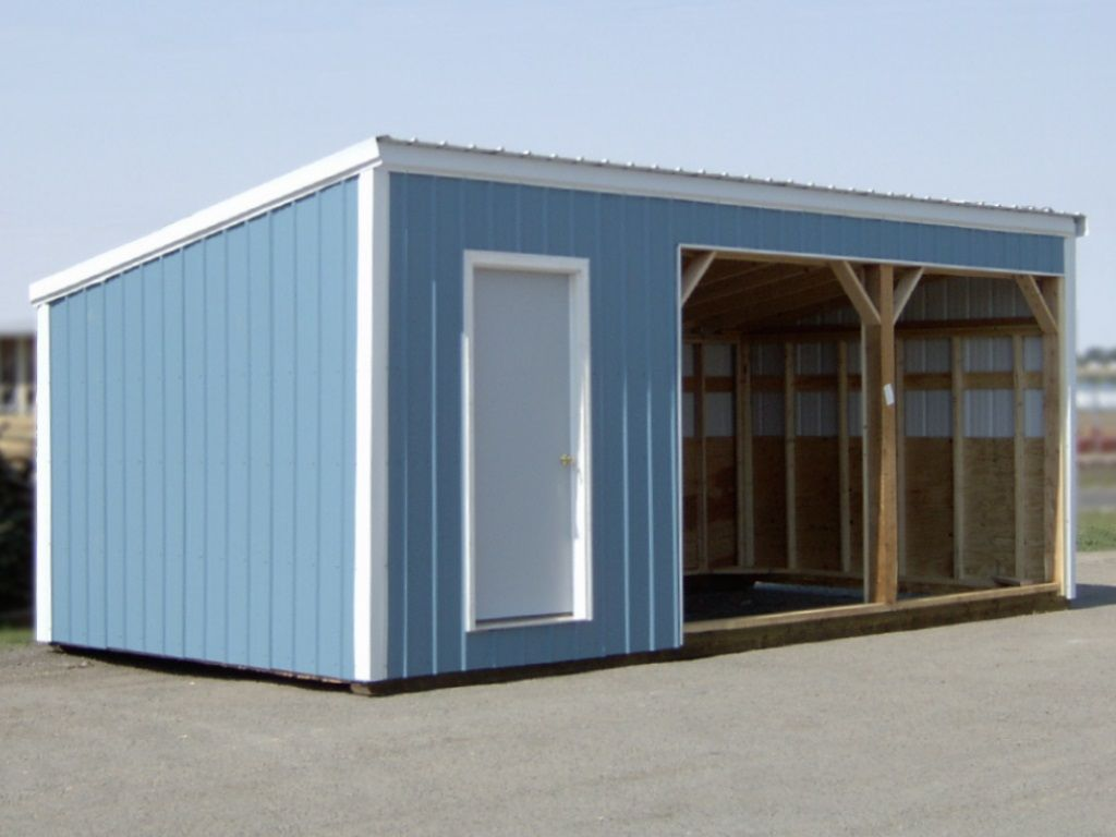 Two-bay livestock shelter with a tack room on one end, all clad in blue steel with white roofing and trim.