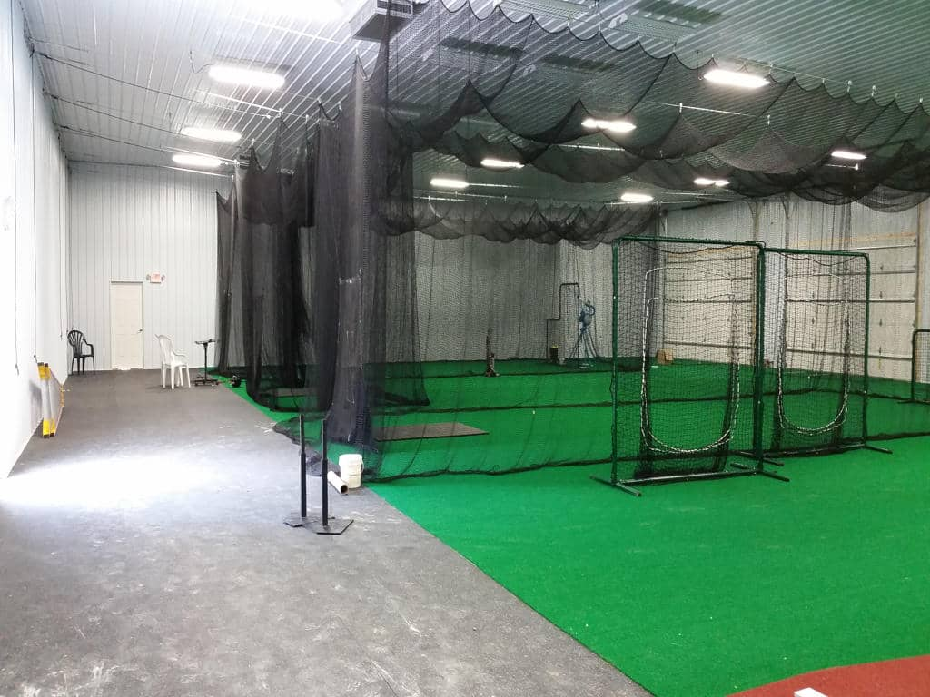 Building interior with driving ranges.