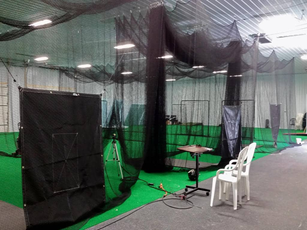 Commercial pole building interior with driving ranges.