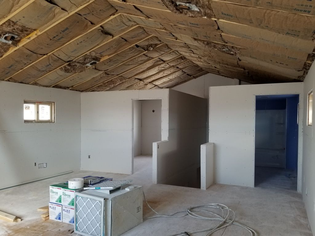 Two rooms that have yet to be finished in the upper level living quarters of a pole building.