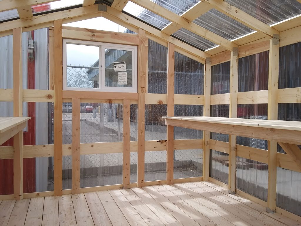 Wooden floor, shelving and framing that make up a greenhouse from S-Bar-S.