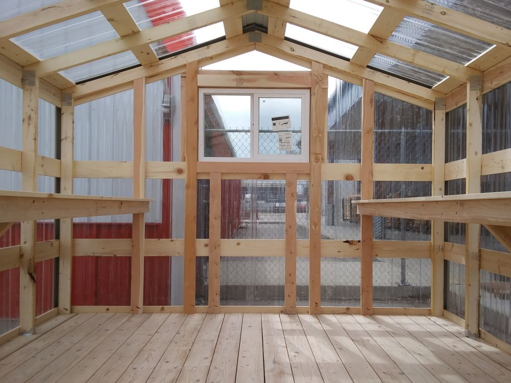 Rear view of the interior of a greenhouse built by S-Bar-S.