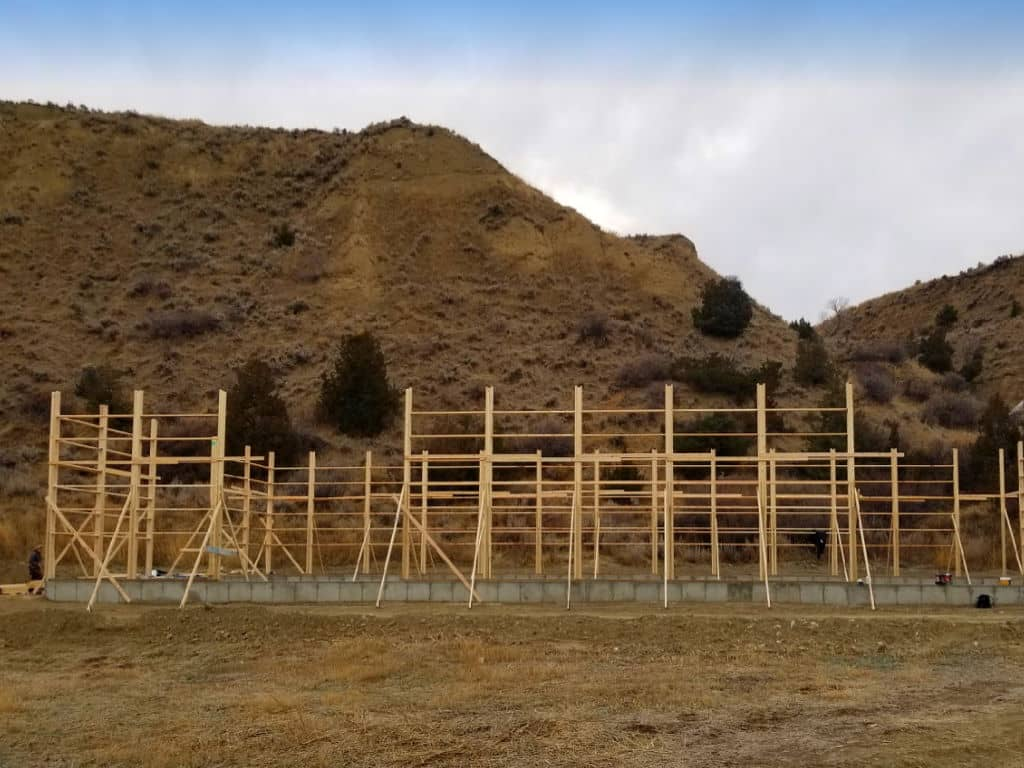 Foundation and framing of a pole barn.