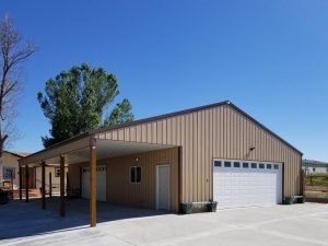 Front and gable end view of a metal-sided pole barn garage with a lean-to on one side.