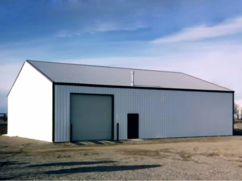 Steel-sided pole building with overhead door, built by S-Bar-S.