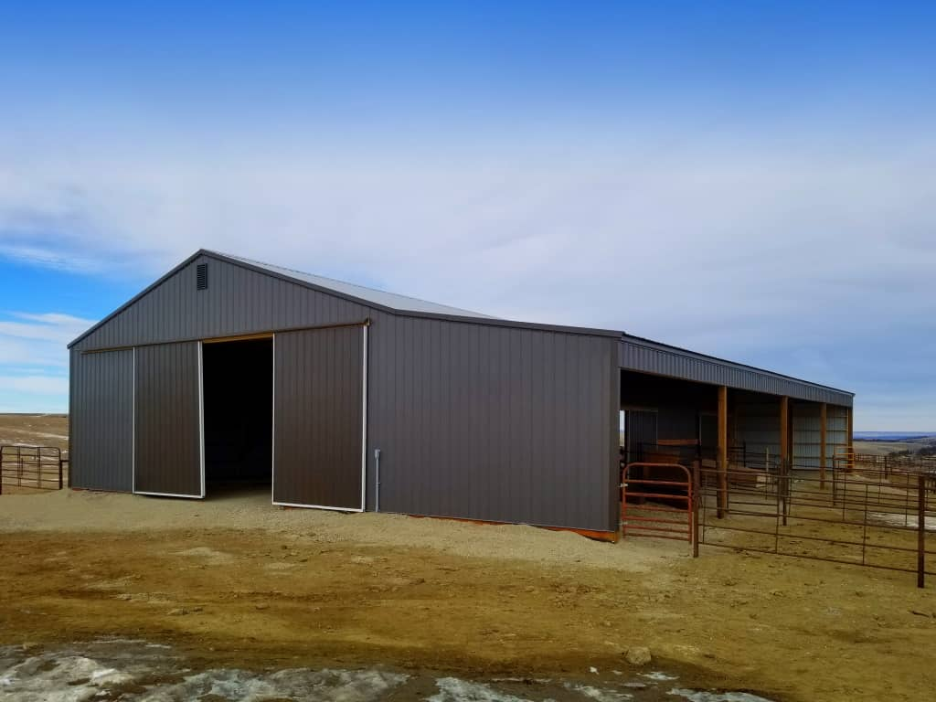 Gable end with sliding barn doors and enclosed lean-to.