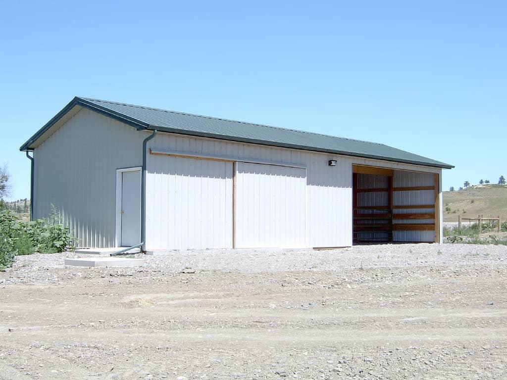 Gable roofed pole barn with walk door on the gable end.