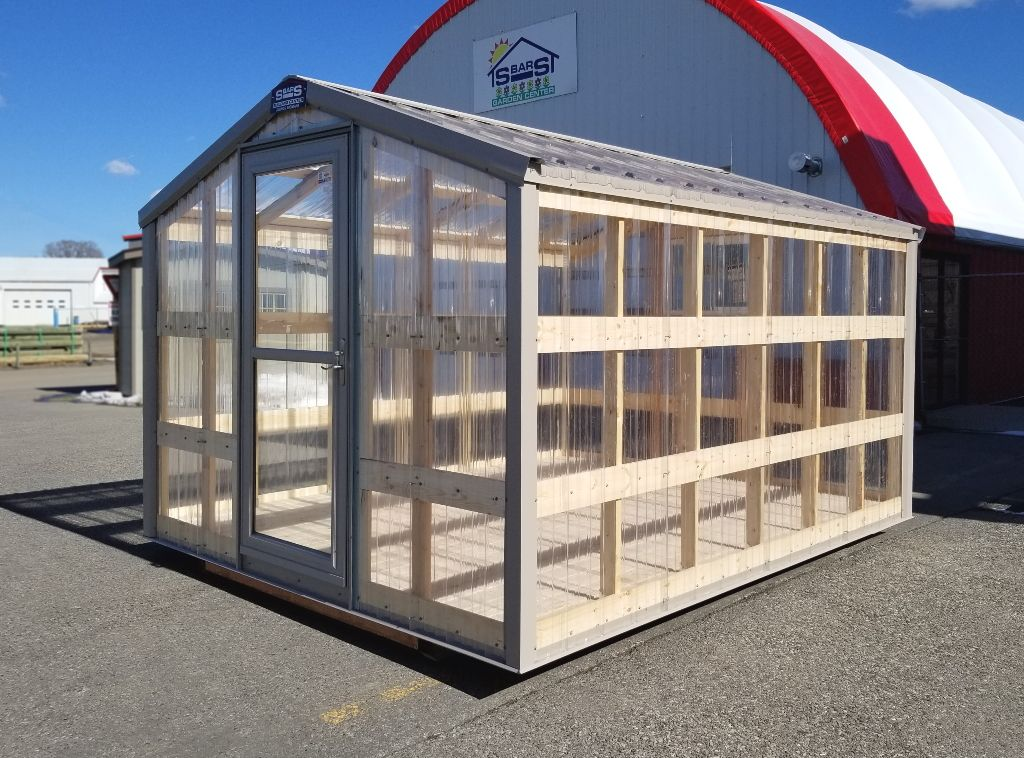 Front and side of a greenhouse built by S-Bar-S.