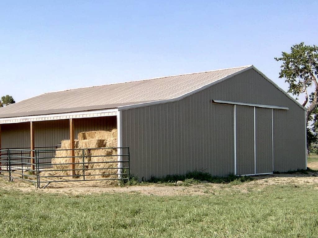 Sliding barn doors on the gable end of a pole barn.