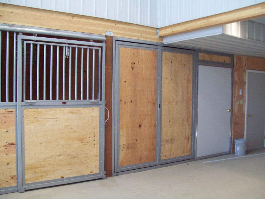 Tack room with rotating door in closed position.