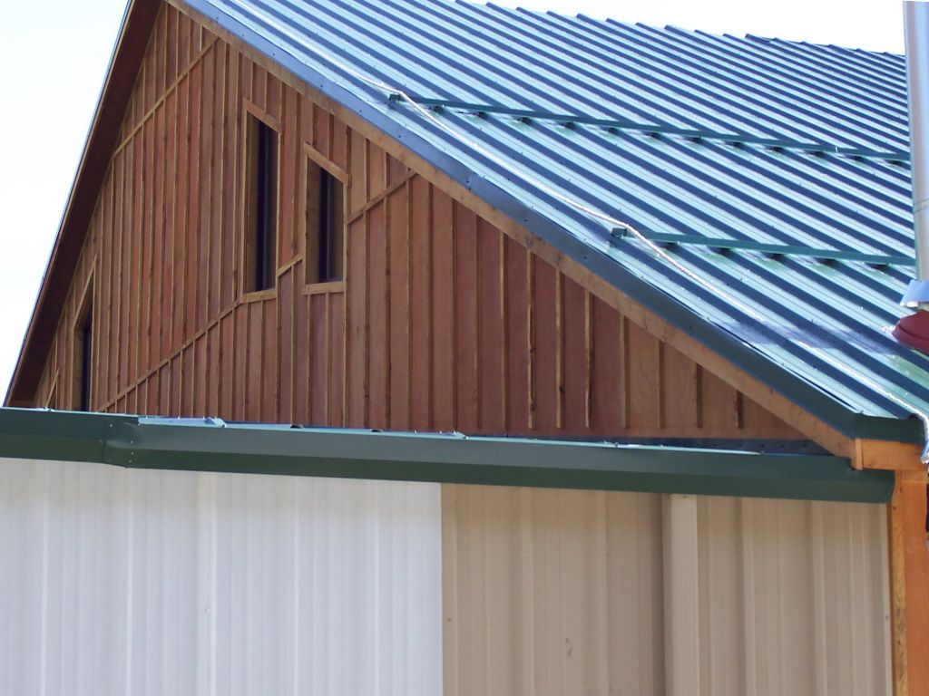 Custom board and batten wood siding used on a riding arena built by S-Bar-S.