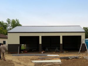 A garage building built by an S-Bar-S construction crew. Three open bays are where overhead doors will be placed.